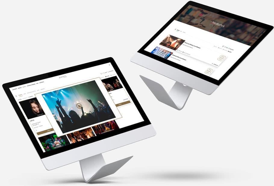 Zwei schwebende iMacs - einer zeigt den Livestream und der andere die Mediathek